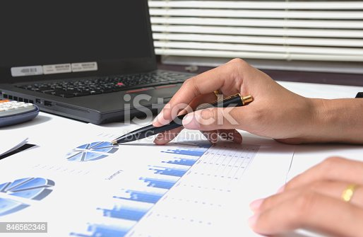 858031152istockphoto Business checking documents on office table with calculator and graph financial. 846562346