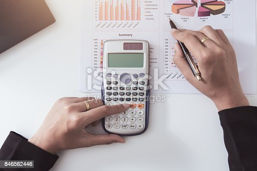 858031152istockphoto Business checking documents on office table with calculator and graph financial. 846562446