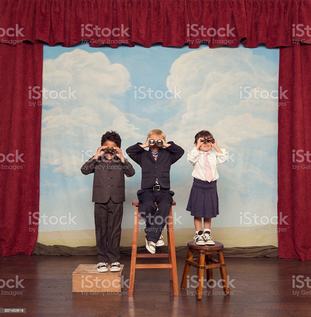 Business Children Look For Profits Through Binoculars stock photo