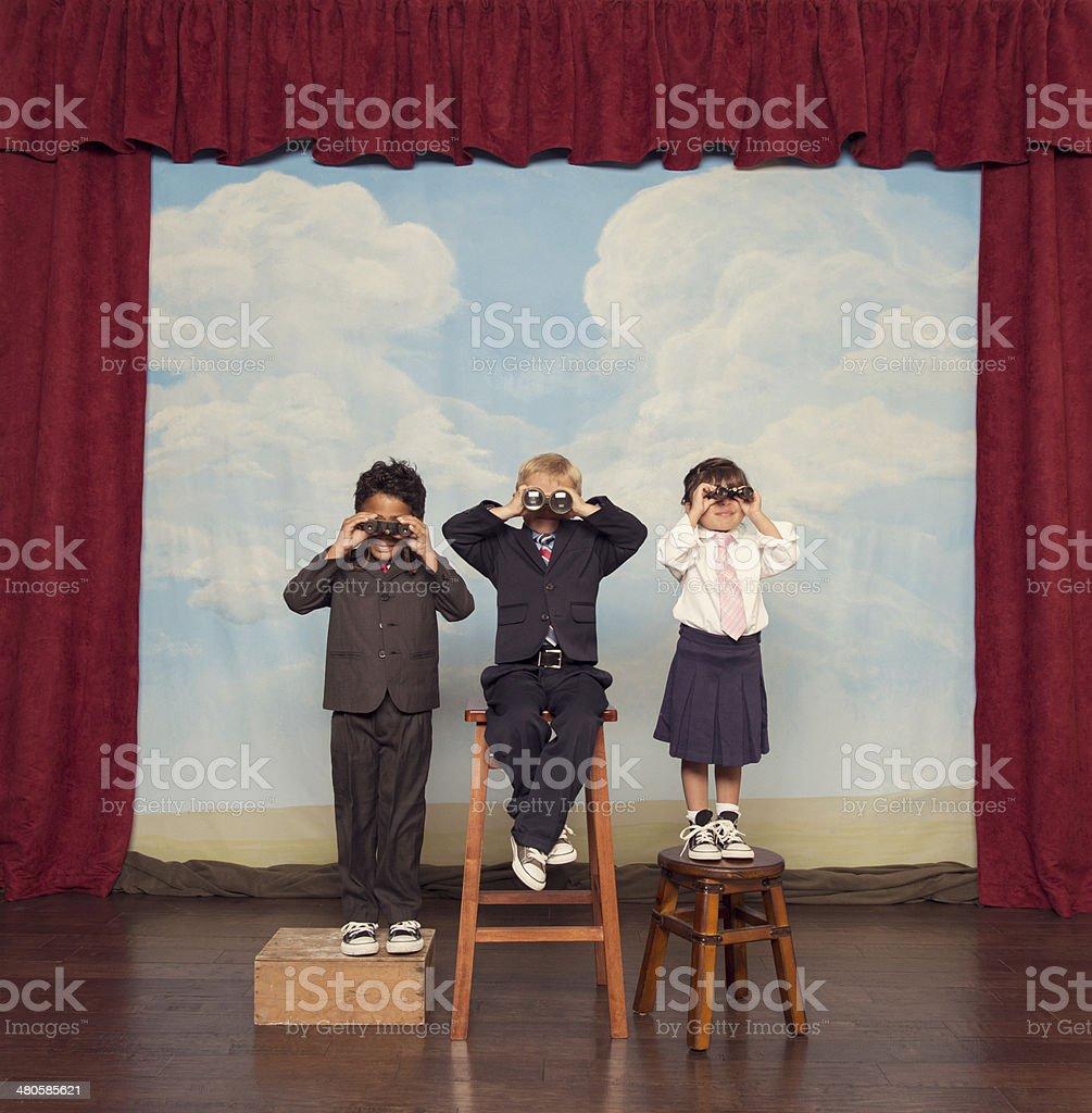 Business Children Looking For Profits Through Binoculars stock photo