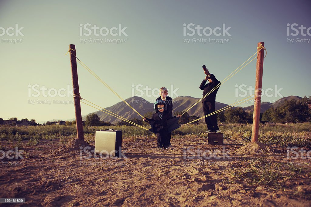 Business Children with Human Slingshot stock photo