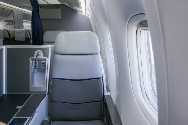 Business class airplane interior Business class airplane interior airplane seat stock pictures, royalty-free photos & images