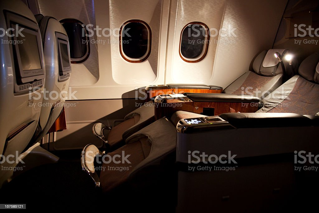 Business class reclined seats of airplane stock photo