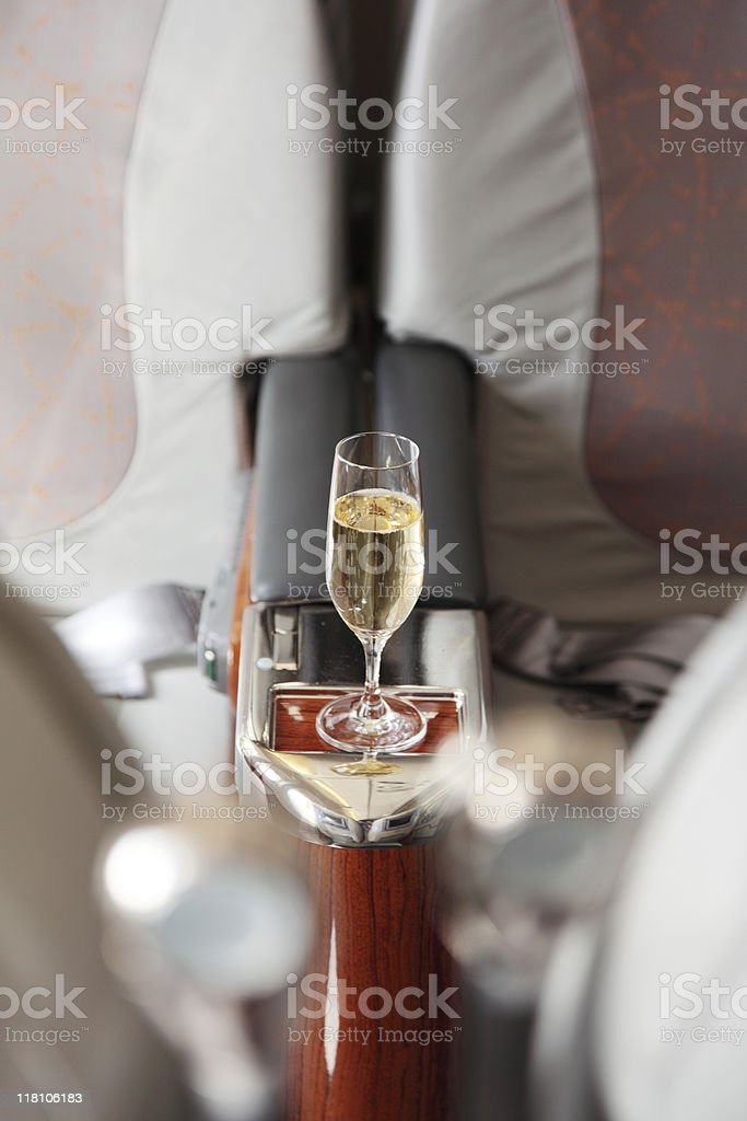 Business Class Seat with served champagne stock photo