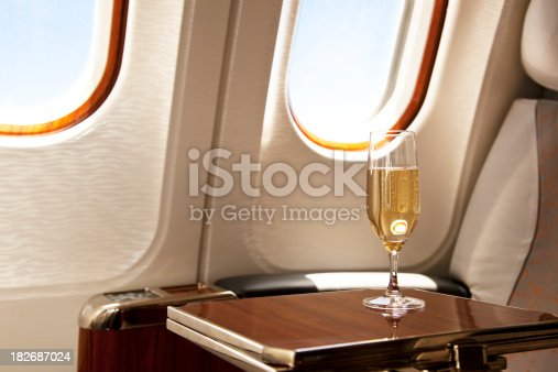 istock Business Class Seat with served champagne 182687024