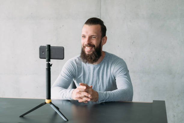 business coaching hipster guy smartphone camera stock photo