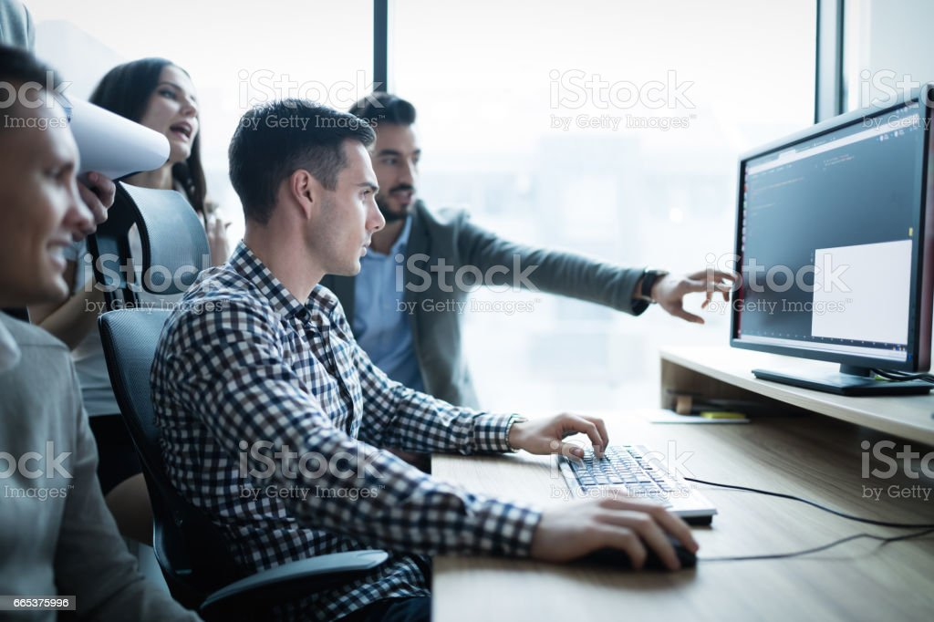 Business collaboration in office by IT colleagues and programmers stock photo