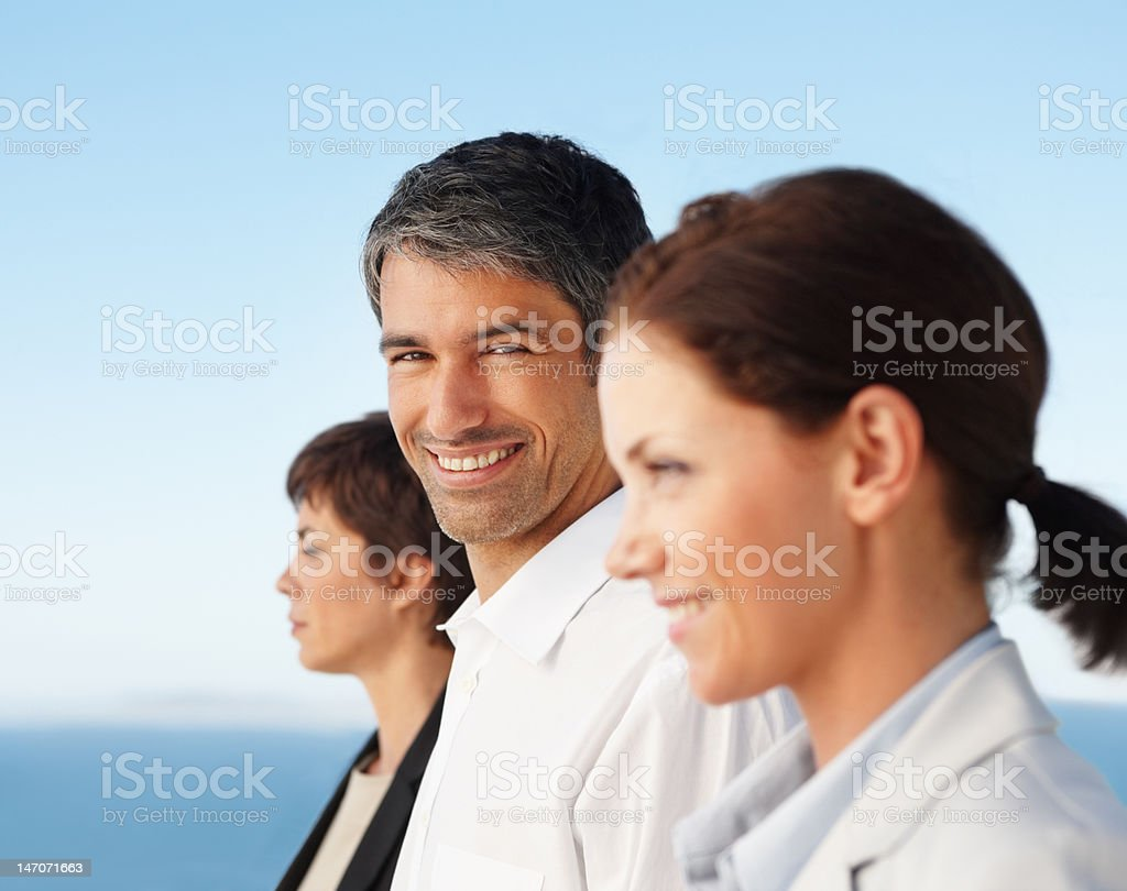 Business colleague standing in a line and smiling royalty-free stock photo