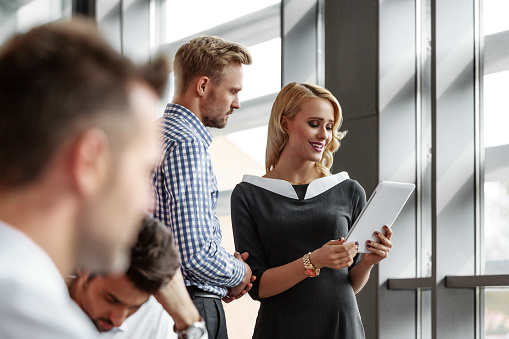 Business Colleague Talking In An Office Stock Photo - Download Image Now