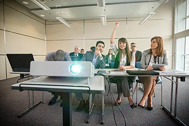 business colleagues attending presentation in office - tageslichtbeamer stock-fotos und bilder