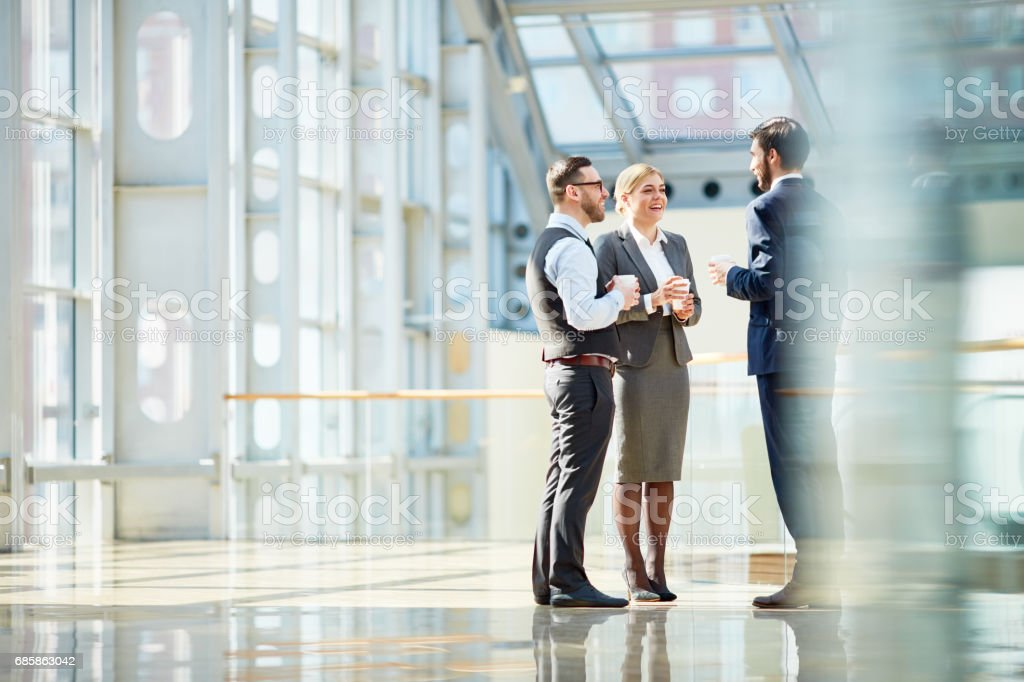 Business Colleagues Chatting at Coffee Break royalty-free stock photo