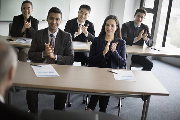 business colleagues clapping hands in learning seminar office classroom - danke an lehrerin stock-fotos und bilder
