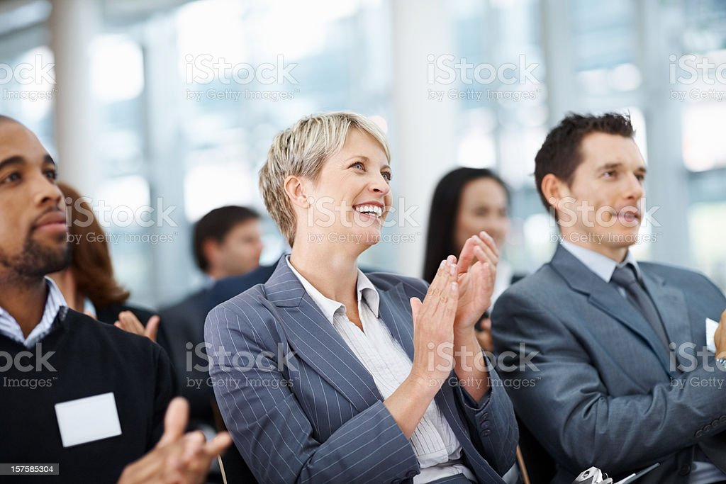 Business colleagues clapping her hand while at a seminar stock photo