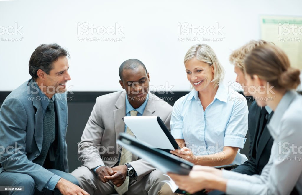 Business colleagues conversing royalty-free stock photo