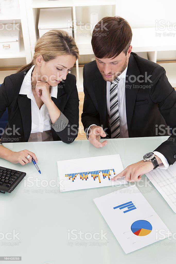 Business colleagues discussing a bar graph royalty-free stock photo