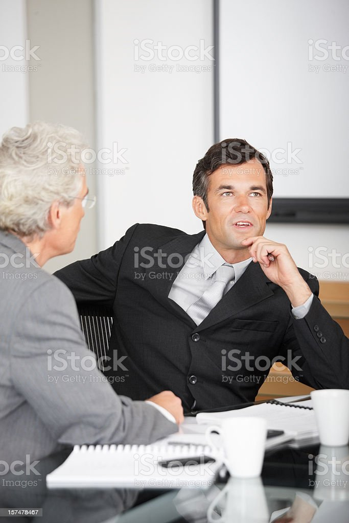 Business colleagues discussing in a meeting royalty-free stock photo