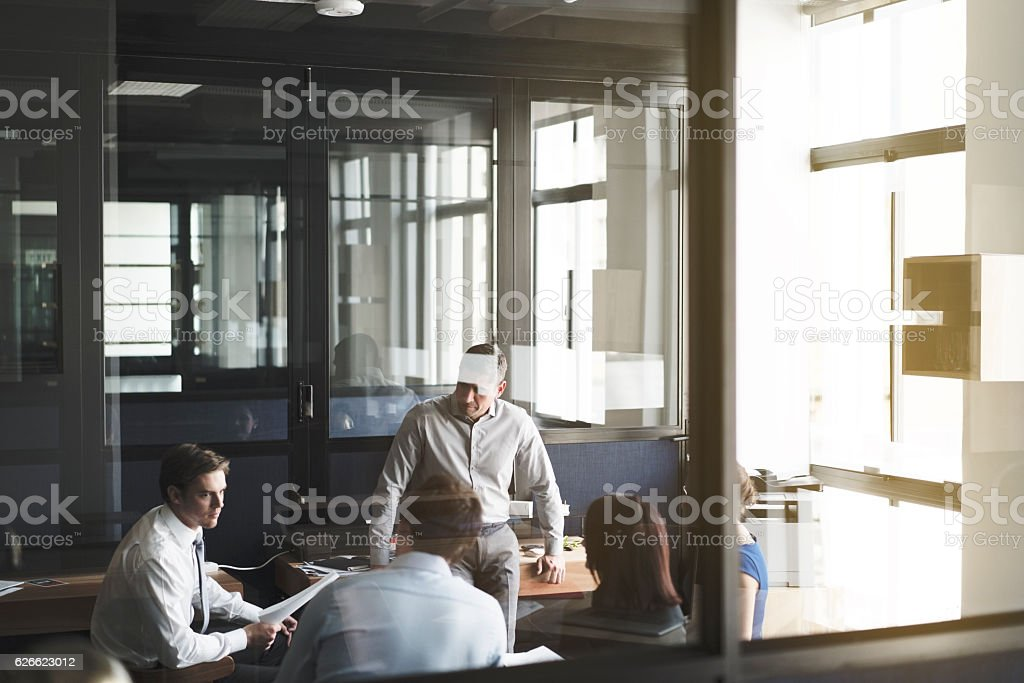 Business colleagues discussing in board room stock photo