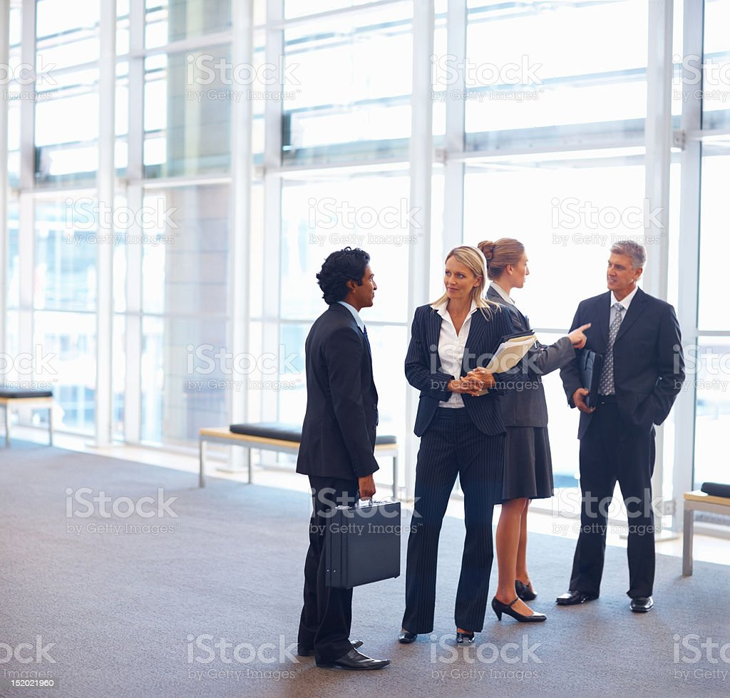 Business colleagues discussing with each other royalty-free stock photo