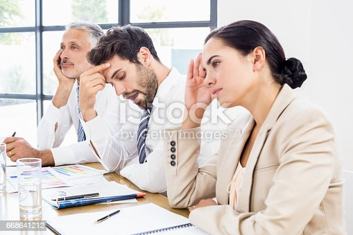 istock Business colleagues getting bored in a meeting 668641212