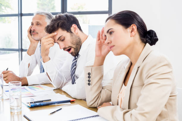 Business colleagues getting bored in a meeting stock photo