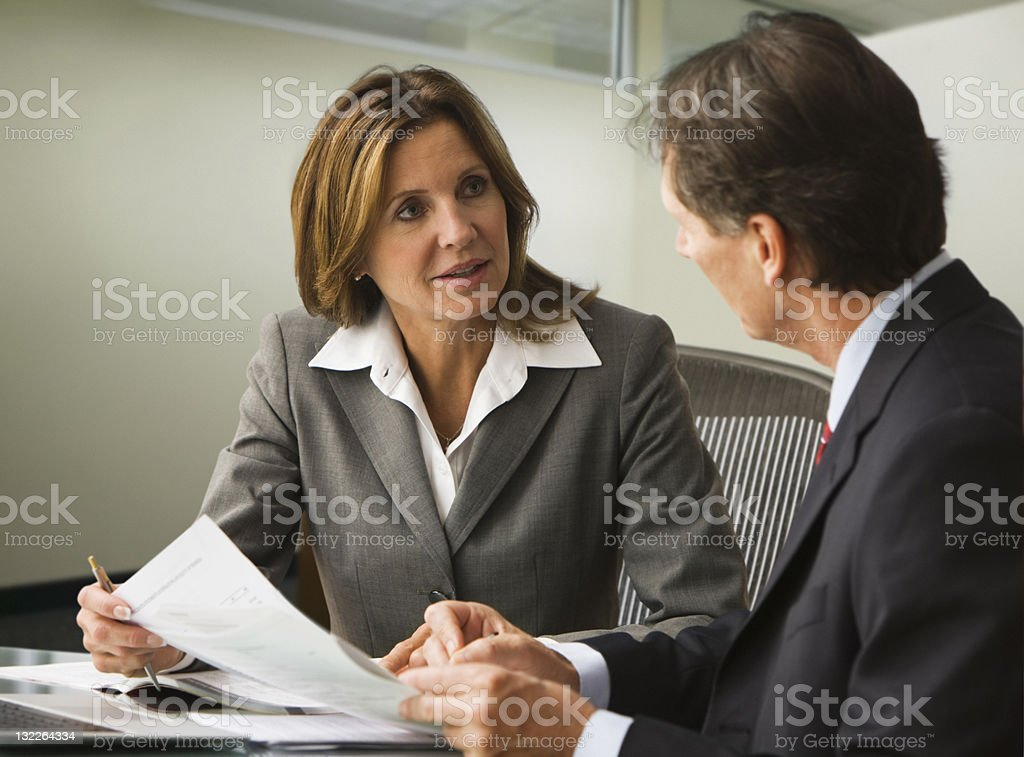Business colleagues going over report royalty-free stock photo