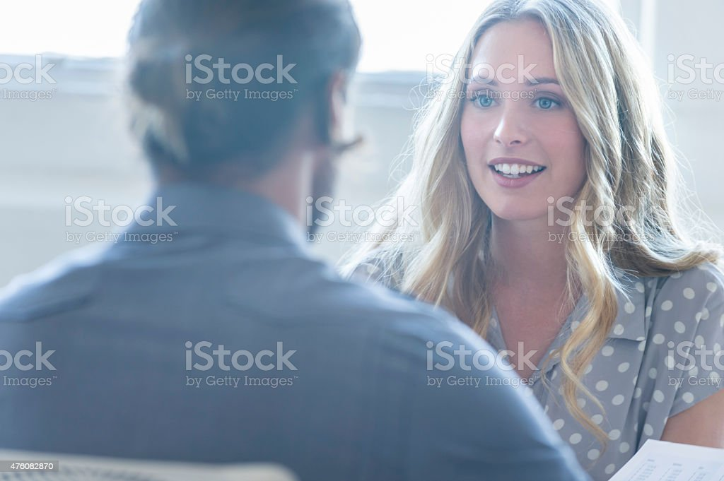 Business colleagues having a conversation. stock photo