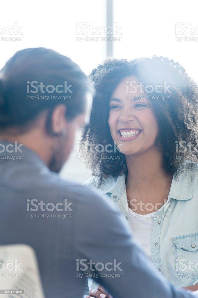 Business colleagues having a conversation. stock photo