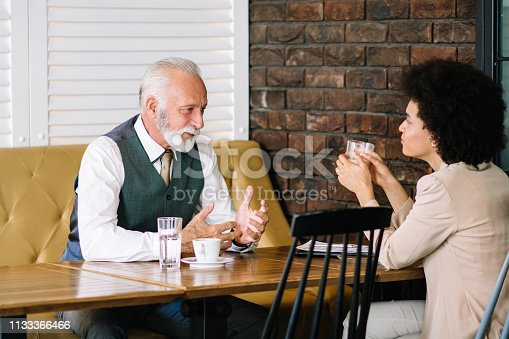Business colleagues having coffee together