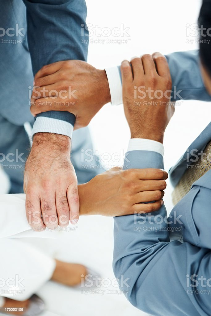 Business colleagues holding each other's hand royalty-free stock photo