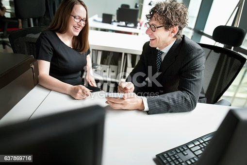 istock Business colleagues laughing together in design office 637869716
