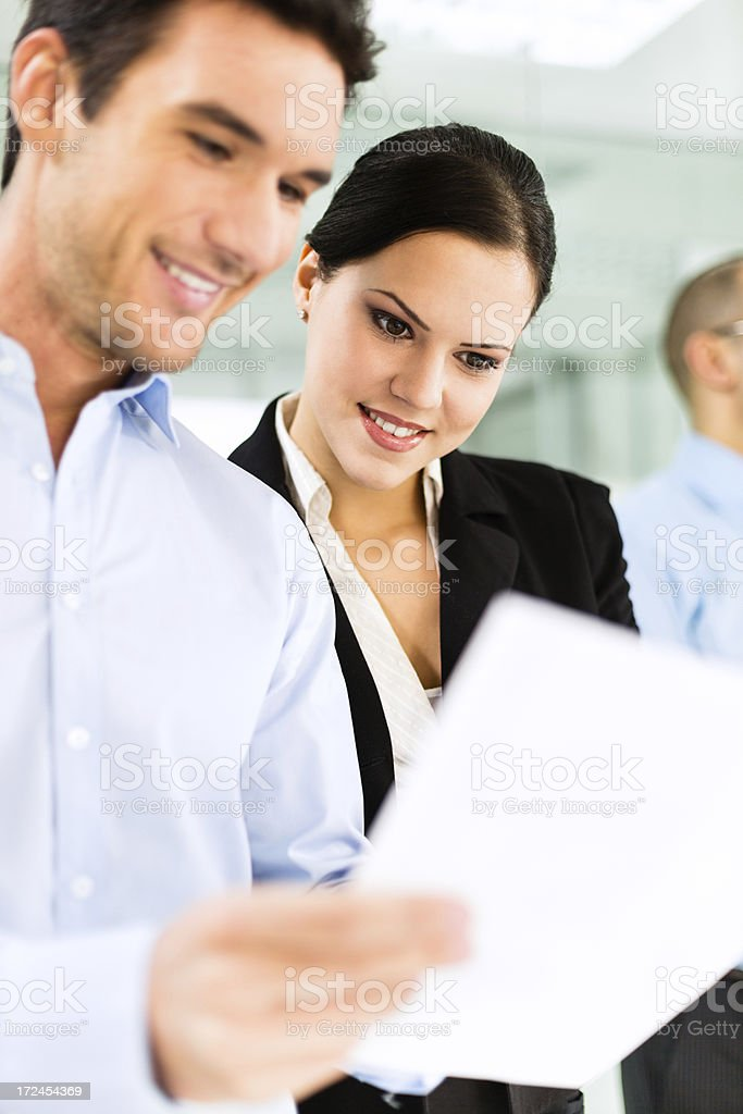 Business colleagues looking at document royalty-free stock photo