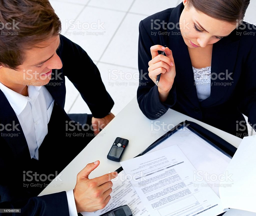 Business colleagues looking at documents royalty-free stock photo