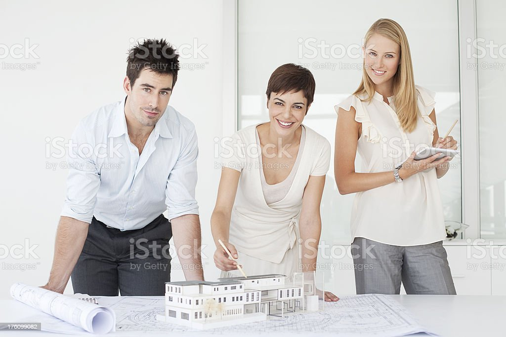Business colleagues looking over plans in office royalty-free stock photo