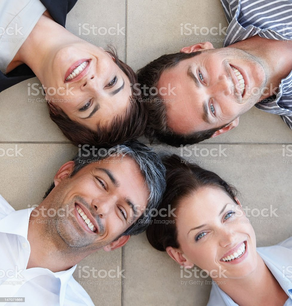 Business colleagues lying on floor and smiling royalty-free stock photo