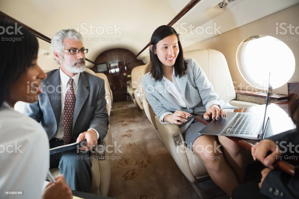 Business colleagues meet on board a private jet stock photo