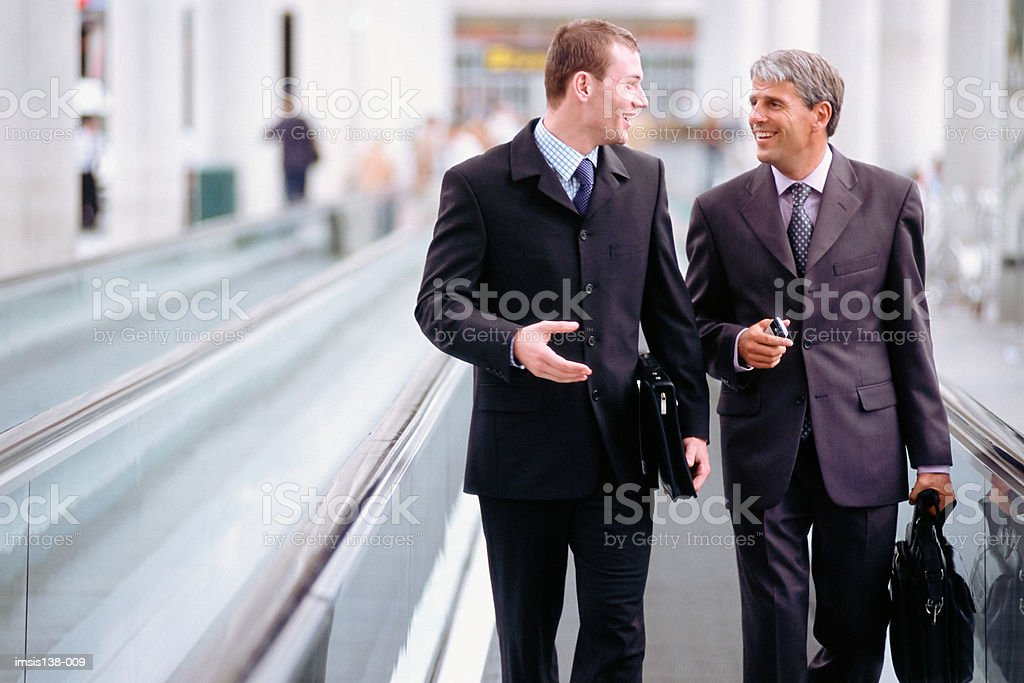 Business colleagues on travelator royalty-free stock photo