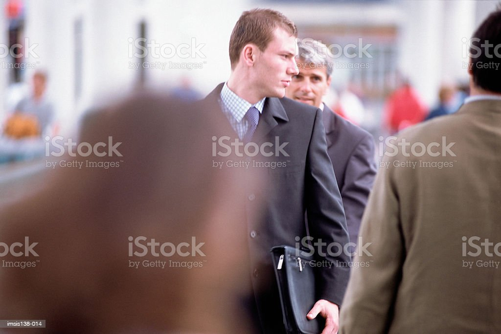 Business colleagues on travelator royalty free stockfoto