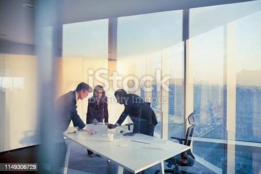 Adult senior diverse multi-ethnic Caucasian Hispanic Middle Eastern CEO executive team business people together in conference meeting room in contemporary modern office bright sunny daylight sunset dusk talking discussing planning organizing strategy well dressed suit and tie teamwork cooperation diversity multi-ethnic problems solutions unity cityscape downtown urban new beginnings breaking new ground dreamlike decisions choices the way forward diversity