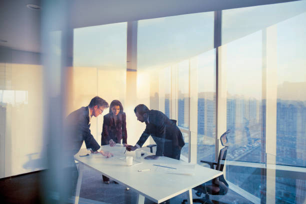 Business colleagues planning together in meeting stock photo