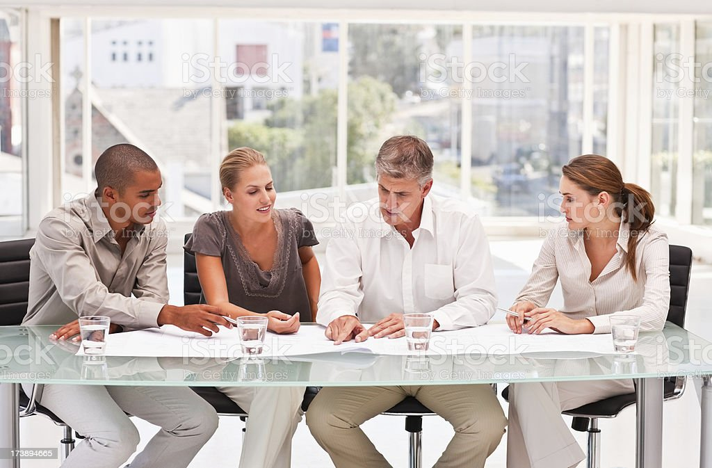 Business colleagues planning together in meeting royalty-free stock photo