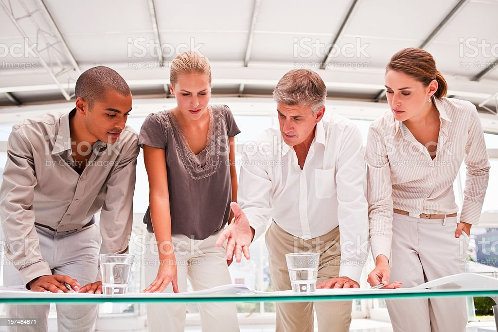 Business colleagues planning together in office royalty-free stock photo
