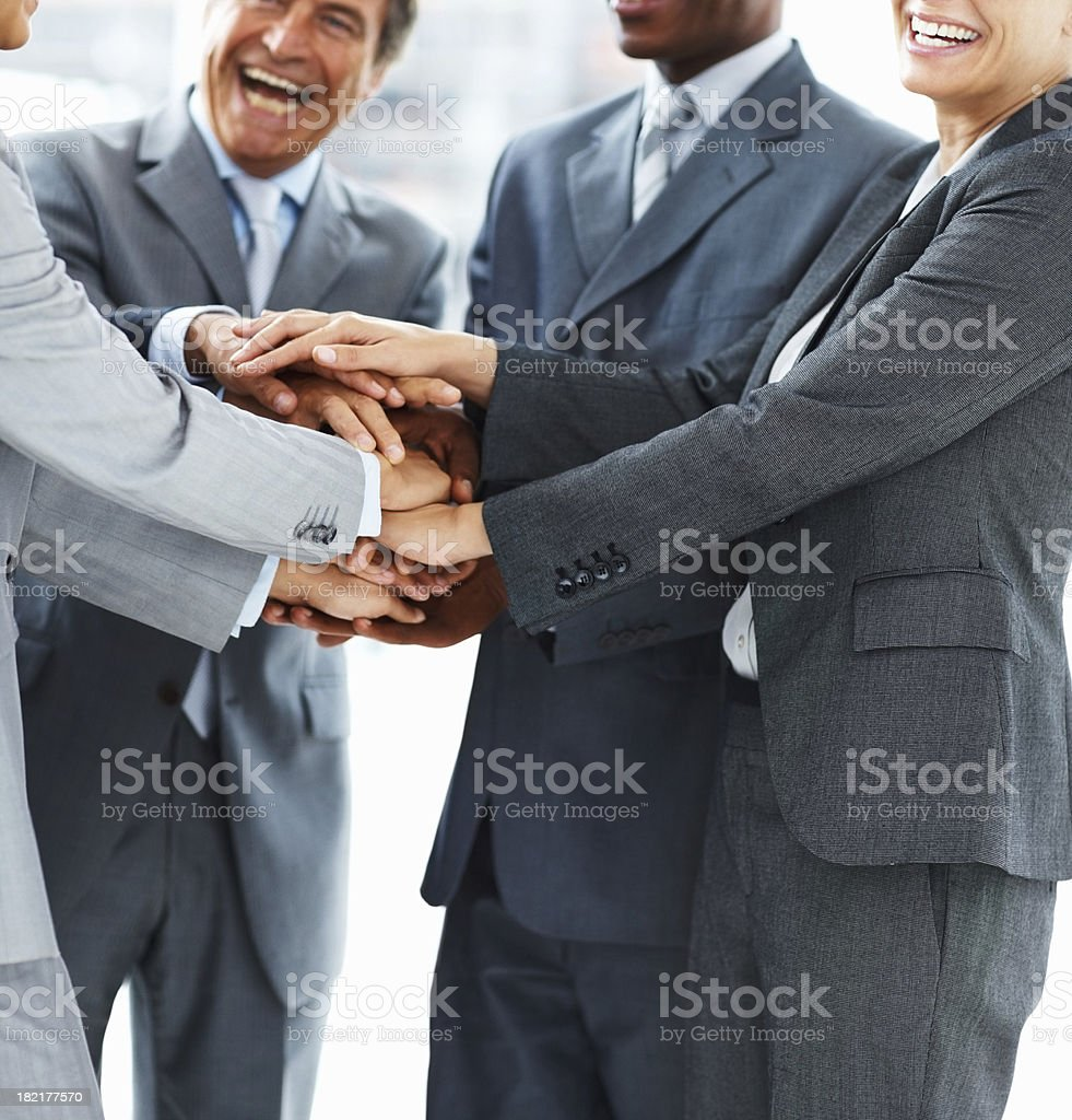 Business colleagues showing unity with stacking their hands royalty-free stock photo
