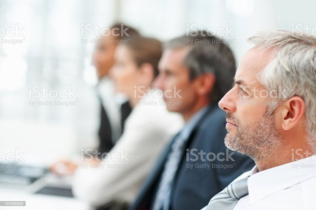 Business colleagues sitting in a row royalty-free stock photo