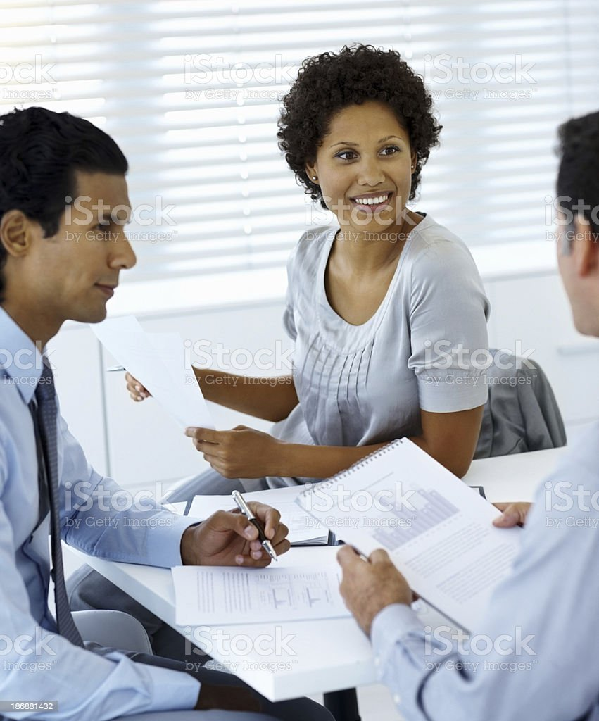 Business colleagues smiling during a meeting in office royalty-free stock photo