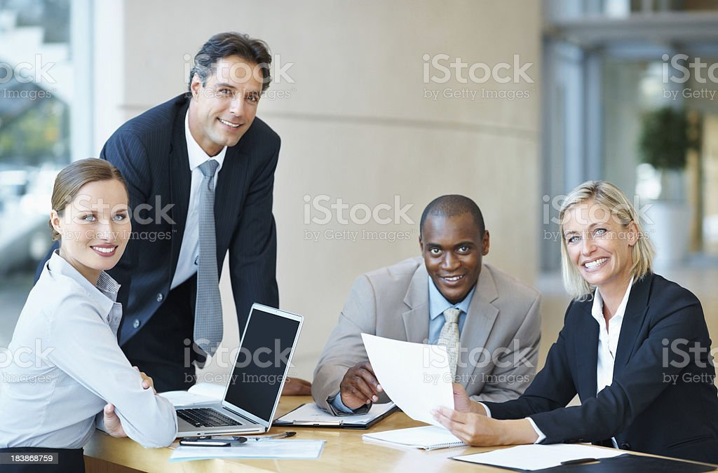Business colleagues smiling in a meeting royalty-free stock photo