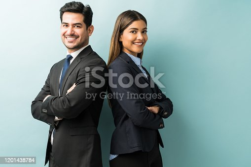 Latin confident professionals in suit standing against isolated background