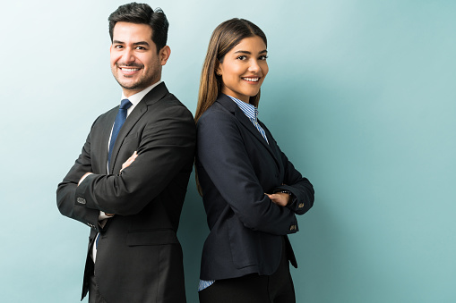 Business Colleagues Standing With Arms Crossed In Studio
