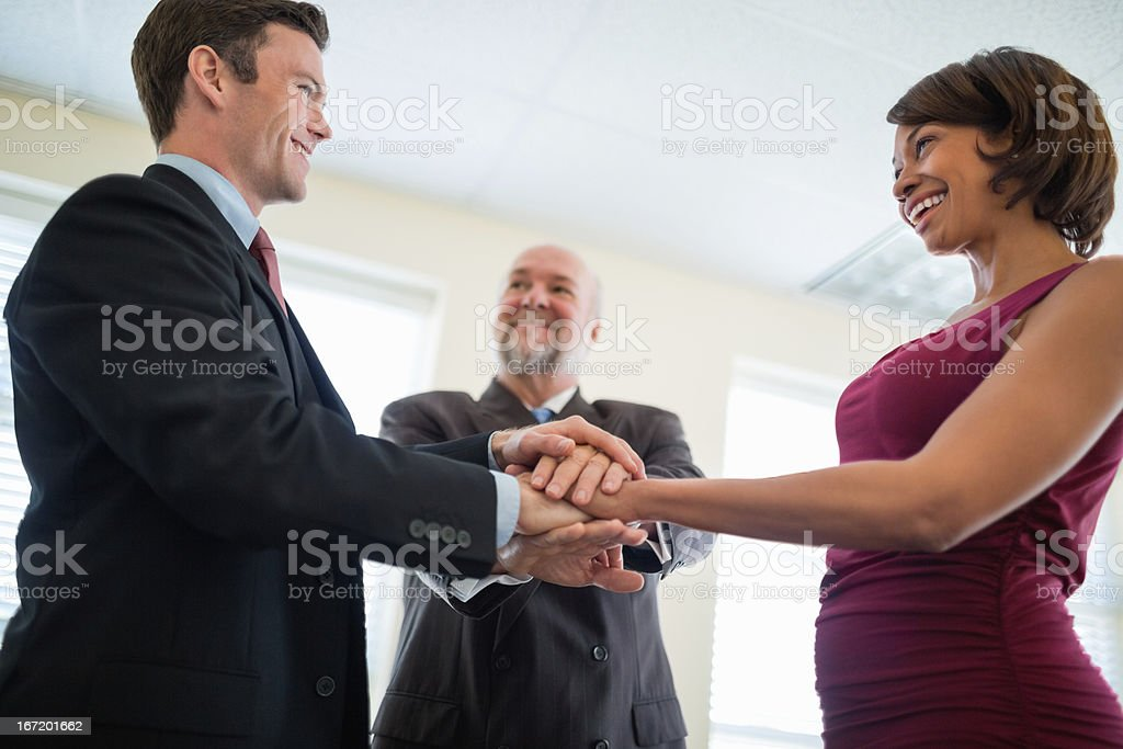 Business Colleagues Symbolizing Teamwork And Unity royalty-free stock photo