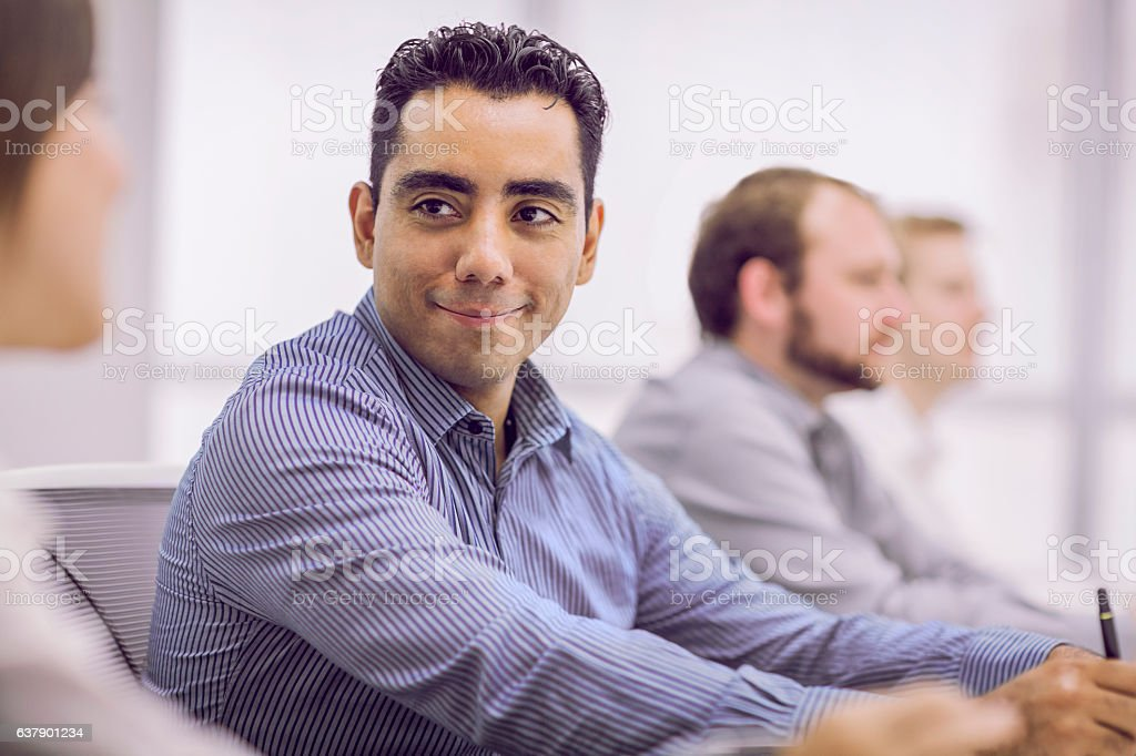 Business colleagues talking during meeting stock photo