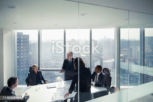 istock Business colleagues talking in meeting room 1149306454